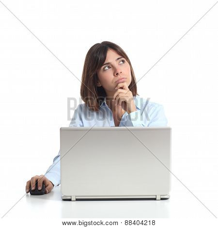 Pensive Woman Thinking While Is Using A Laptop