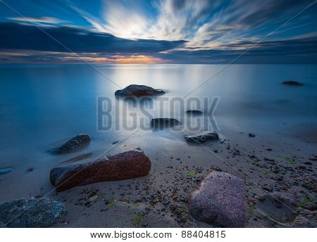 Rocky Sea Shore At Sunrise. Beautiful Seascape