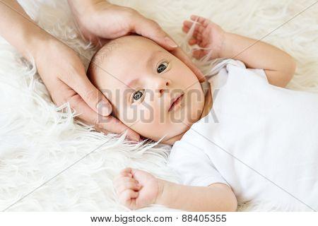 Cute Newborn In Mother's Hands Lying