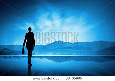 Rear view of businesswoman looking at picturesque nature landscape