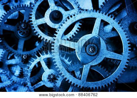 Grunge gear, cog wheels background. Concept of industrial, science, clockwork, technology.  Blue tint