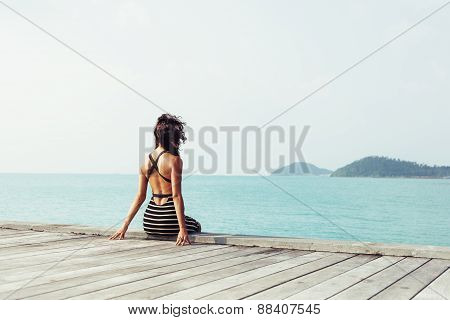 Young Pretty Woman Sitting Alone On The Pier