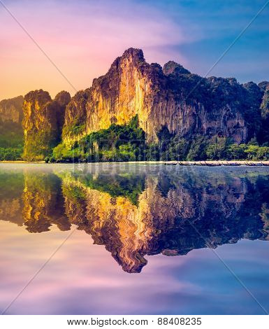 Beautiful sunset with reflection in tte water. Thailand, Krabi province, Railay beach