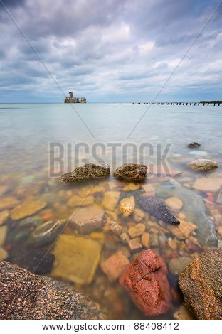 Baltic Rocky Coast With Old Military Buildings From World War Ii And Wooden Breakwaters.