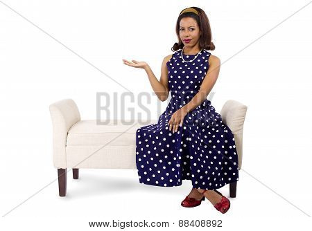 Woman in Polka Dot Dress Presenting Something