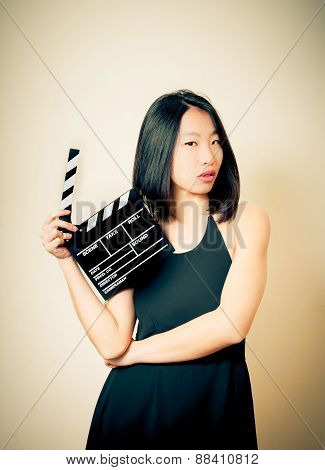 Beautiful Asian Woman With Movie Clapper Board Vintage Colors Effect