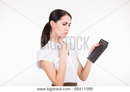 Business Woman With Calculator Thinking
