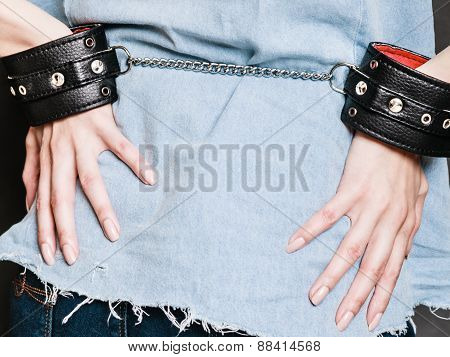 Arrest And Jail. Closeup Handcuffs On Female Hands