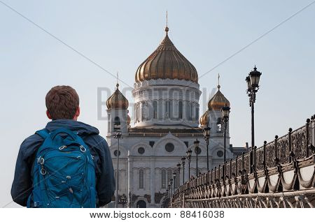 Man, traveler watching peaceful landscape. Tourists visiting. Cathedral of Christ the Saviour. Russi