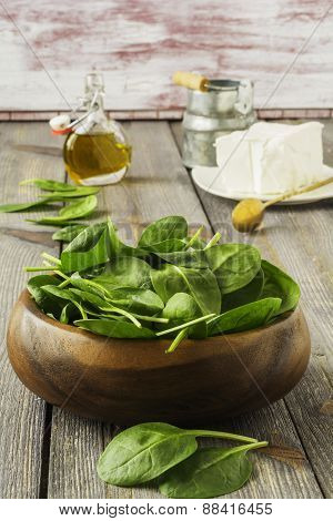 Raw spinach with olive oil and feta cheese.