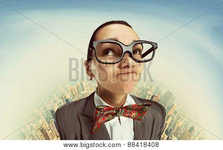 Funny dreaming nerd girl