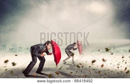 Businessman and businesswoman in storm
