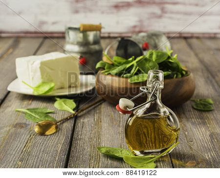 Olive oil with feta cheese and raw spinach.