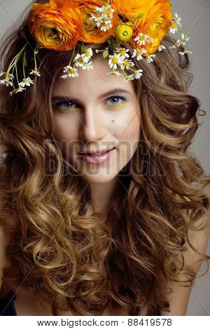 Beauty young woman with flowers and make up close up, real sprin