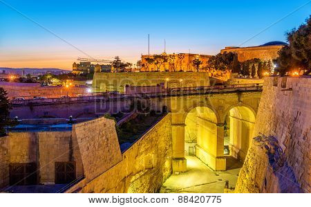 Sunset Over City Walls Of Valletta - Malta