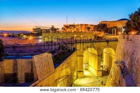 Sunset Over City Walls Of Valletta - Malta