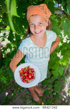 Girl with fresh strawberries