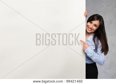 Beautiful woman showing a white board