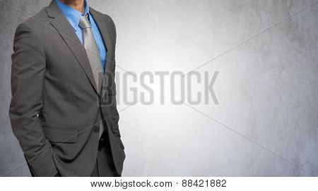 Impersonal portrait of a businessman against a grey concrete background