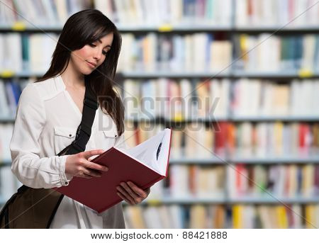 Portrait of a young woman reading a book