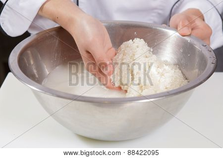 Cook washes rice