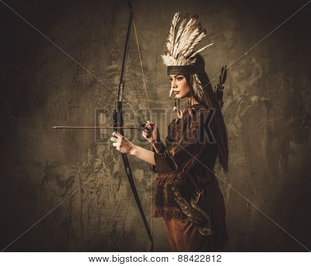 Indian woman hunter with bow and prey bird