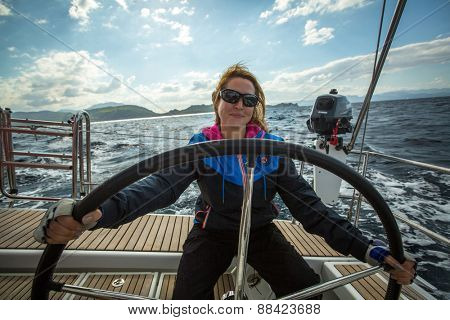 HYDRA, GREECE - CIRCA OCT, 2014: Unidentified sailor participates in sailing regatta 12th Ellada Autumn 2014 among Greek island group in the Aegean Sea, in Cyclades and Argo-Saronic Gulf.