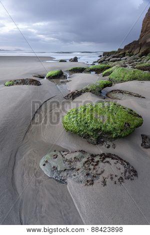 Rocks lead way to Pacific Ocean.