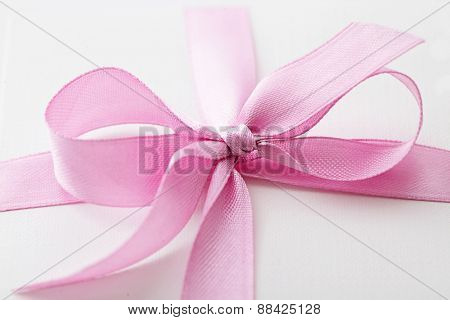 gift box. close-up of pink ribbon bow