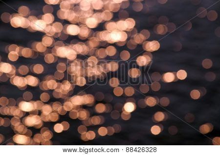 blur golden light on water