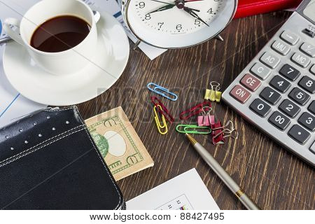 Alarm clock notepad and calculator lying on table