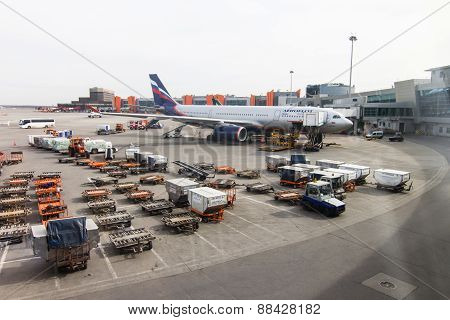 Flight Field, Aeroflot Aircraft And Loading Trucks Before Taking Off