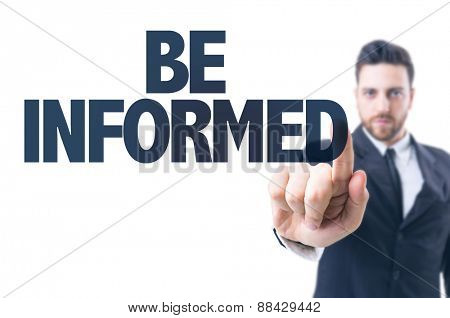 Business man pointing the text: Be Informed
