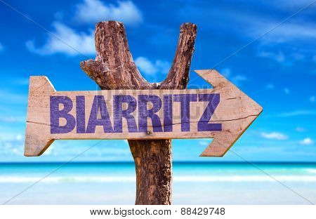 Biarritz wooden sign with beach background