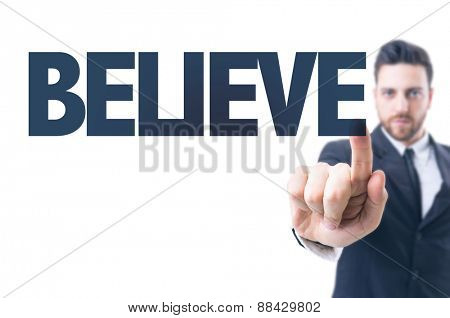 Business man pointing the text: Believe
