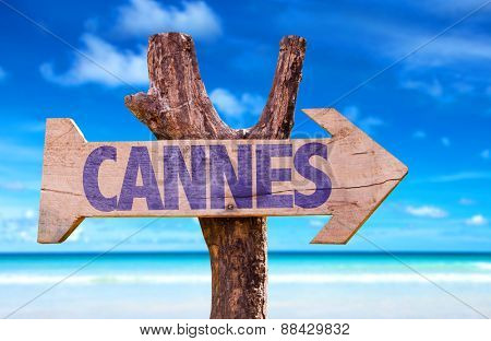 Cannes wooden sign with beach background