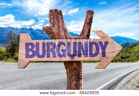 Burgundy wooden sign with road background