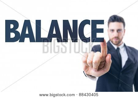 Business man pointing the text: Balance