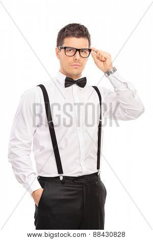 Vertical shot of an elegant guy holding his glasses and looking at the camera isolated on white background