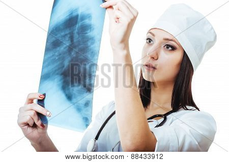 Female doctor looking at an x-ray,isolated on white background