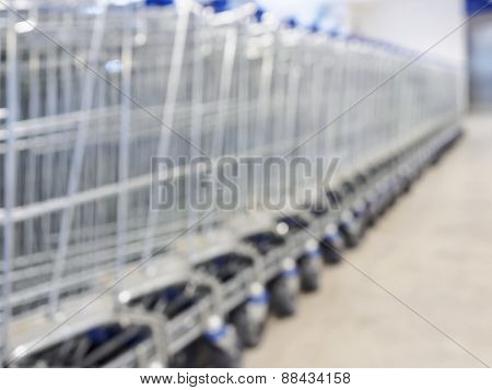 Blurred Trolley supermarket basket in row