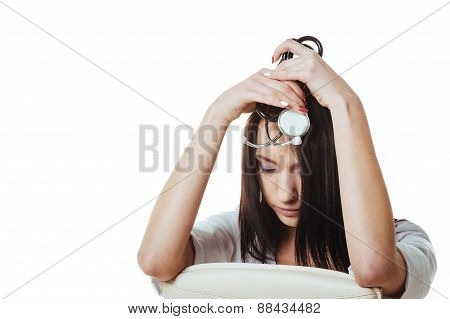Medical doctor woman with stethoscope have a problem, hold hand head stress , concept of negative em