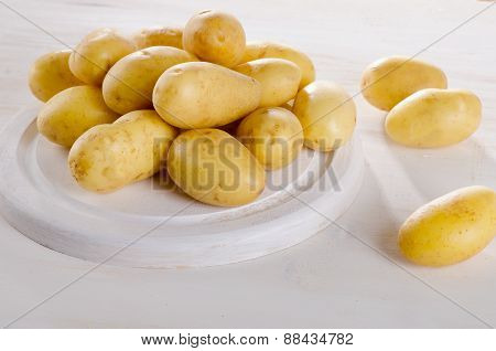 Fresh Organic Potatoes On A Wooden Table