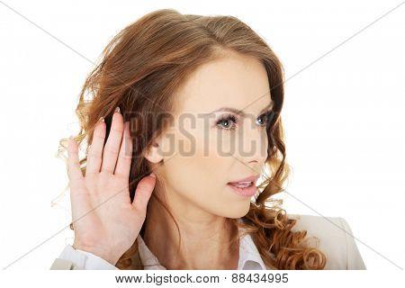 Beautiful businesswoman overhears a conversation.