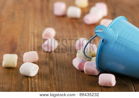 Sweet Marshmallows Spilling From  A Bucket.