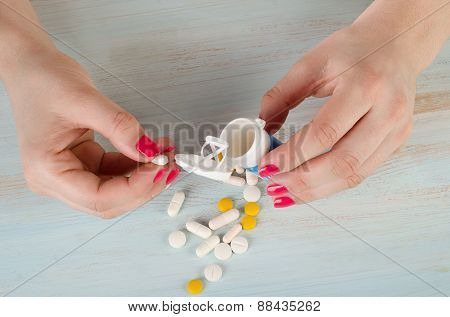 Young Woman Hands Holding  White And Yellow  Pills.