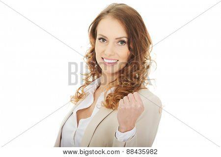 Beautiful successful businesswoman making fist.