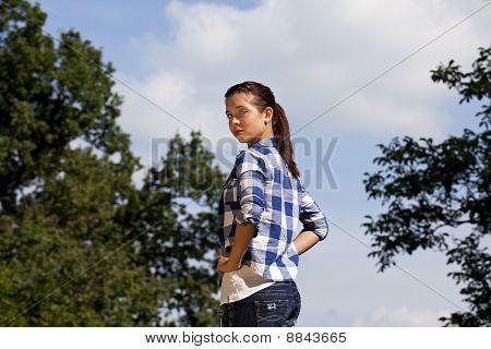 cool looking brunette teenage girl