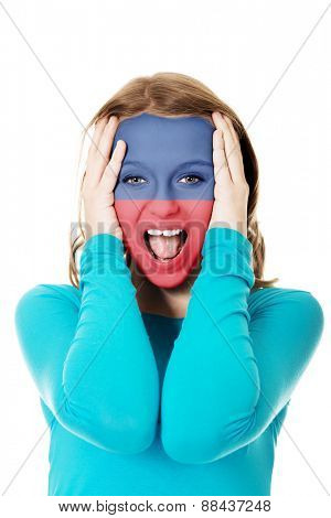 Woman with Liechtenstein flag painted on face.
