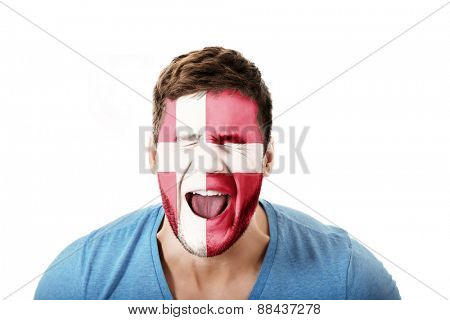 Screaming man with Denmark flag painted on face.